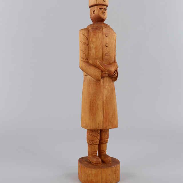 Plastika drevená rezbára - baníka Al. Scholza: Muž s holubicou