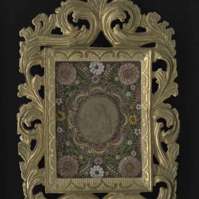 Obraz kláštorný v ráme - sv.Uršula?, voskový reliéf, Pius VII. Pontific, staniol, textilné a kovové nite, vyrezávaný a pozlátený rám 43x26?
